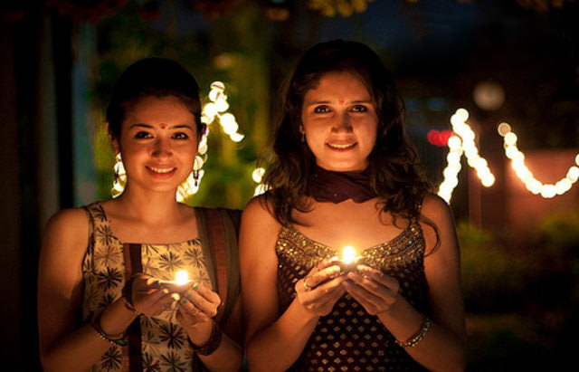 Diwali Girls with Diya Lights Lamp
