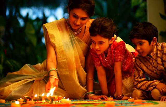 Lady Children Celebrating Deepavali with Diyas