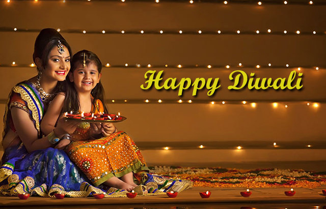 Cute Mom Daughter Celebrating Diwali photos