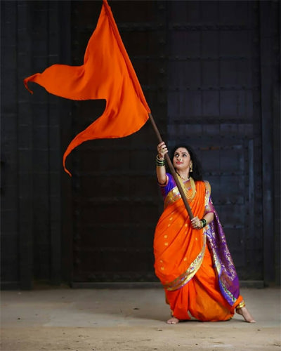 Bhagwa Flag in Ladies Hand